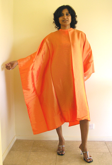 """Impresso"" Crinkle Woven-2 Tone Water Repellent Hairdressering Cape with Studs-Orange"